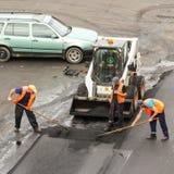 Work to level asphalt. Stock Photos
