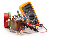 Work to repair electric. Transformer, multimeter, tester, connection wires, electrical tape on white background Royalty Free Stock Images