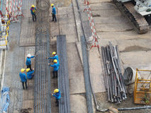 Work together. Workers work together to make stake of building by steel wire Stock Photo