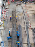 Work together. Workers work together to make stake of building by steel wire Stock Image