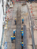Work together. Workers work together to make stake of building by steel wire Royalty Free Stock Photo