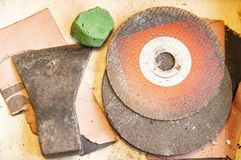 Work tool - an ax, goya paste, discs for cutting metal. Background. Place for text royalty free stock image