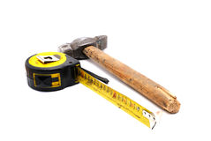 Work tool series: Old tape measure and hammer Royalty Free Stock Image