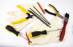 Work tool on white background - screwdriver, pliers, needle file stock photo