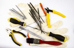 Work tool on white background - screwdriver, pliers, needle file stock images