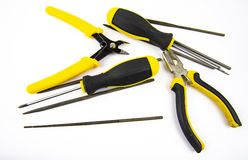 Work tool on white background - screwdriver, pliers, needle file royalty free stock image