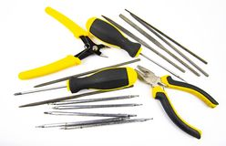 Work tool on white background - screwdriver, pliers, needle file stock photography