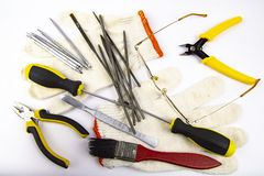 Work tool on white background - screwdriver, pliers, needle file royalty free stock photo