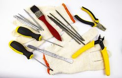 Work tool on white background - screwdriver, pliers, needle file royalty free stock images