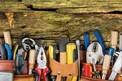 Work tool. Craftsperson mechanic repairman belt tool belt carpentry stock photo