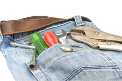 Work tools in with Blue jeans. And handy man Stock Images