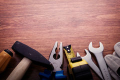 Work Tools at Bottom Border Frame on Wooden Table Stock Photos