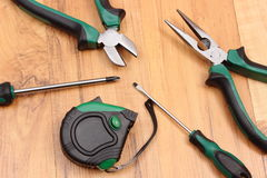 Work tools for engineer on wooden surface, technology. Metal pliers, electrical screwdrivers and tape measure on wooden surface, work tools and accessories for stock photos