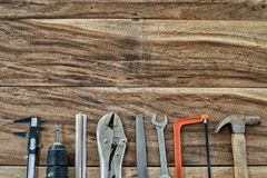 Work Tools frame on wood background Royalty Free Stock Image