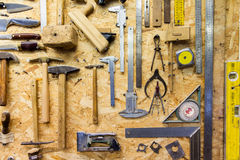 Work tools hanging on wall at workshop Royalty Free Stock Photo