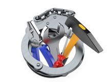 Work tools inside hand cuffs. Isolated on white background Royalty Free Stock Photography