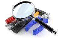 Work tools with magnifying glass Stock Photo