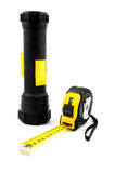 Work tools, measure tape and flashlight Royalty Free Stock Image
