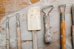 Work tools in a messy ceramics workshop Stock Photography