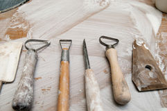 Work tools in a messy ceramics workshop Stock Photos