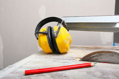 Work tools saw cutter to cut tile, protective headphones Royalty Free Stock Photography