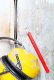 Work tools saw cutter to cut tile, protective headphones Stock Image