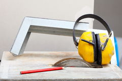 Work tools saw cutter to cut tile, protective headphones Stock Photo