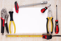 Work tools and sheet of paper. Stock Photo