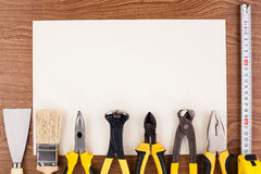 Work tools and sheet of paper. Royalty Free Stock Photo