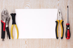 Work tools and sheet of paper. Stock Photography