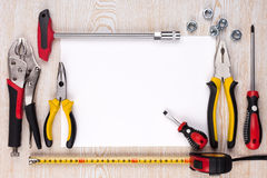 Work tools and sheet of paper. Royalty Free Stock Photography