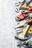 Work tools. Variety of tools on white textured background with copy space Stock Photos