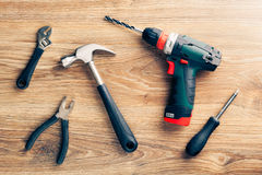 Work tools on wooden background Royalty Free Stock Photos
