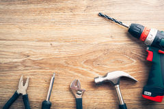 Work tools on wooden background Royalty Free Stock Image