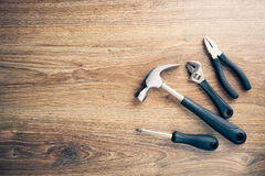 Work tools on wooden background Royalty Free Stock Images