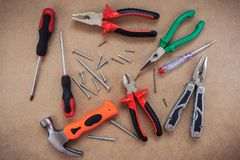 Work tools on wooden fiberboard royalty free stock images