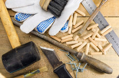 Work tools on a wooden table. Different old carpentry tools and fasteners, on a wooden background royalty free stock photos