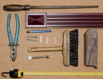 Work tools on a wooden table. Different old carpentry tools and fasteners, on a wooden background Royalty Free Stock Image