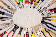 Work tools on wooden texture. Work tools lined up in a circle on a wooden background stock photography
