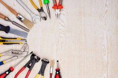 Work tools on wooden texture. Stock Image