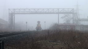 Work train moves on rails paths in fog. Rails to the sleepers go away into the fog with poor visibility stock footage