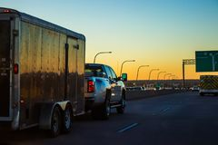 Work truck towing on the highway stock photo
