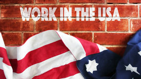 Work In The USA. Flag And Bricks Stock Photo