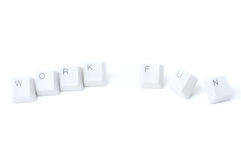 Work vs fun. Keypad buttons, creating words work and fun isolated on white background stock photography