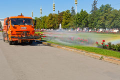 Work watering machine on public park Royalty Free Stock Images