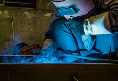 Work a welding workers in factories. Welding work issued strong dazzling rays of light Royalty Free Stock Image