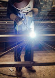Work a welding workers in factories. Welding work issued strong dazzling rays of light Royalty Free Stock Photography