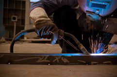 Work a welding workers in factories. Welding work issued strong dazzling rays of light Royalty Free Stock Photos