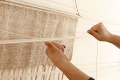 Work whit a handloom. A woman make a cloth whit an ancient loom stock photography