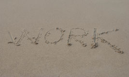 Work written in a sandy tropical beach Stock Photography